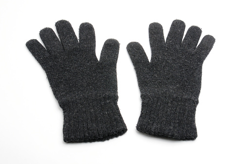 Winter knitted woolen gloves on isolated white background\