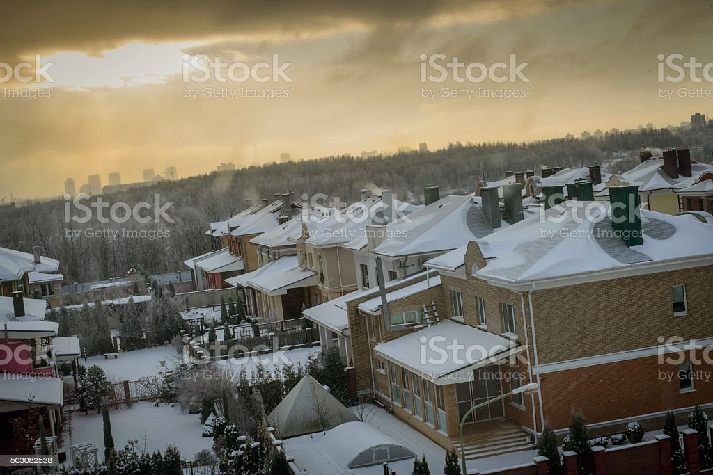 winter landscape. Houses in the city stock photo