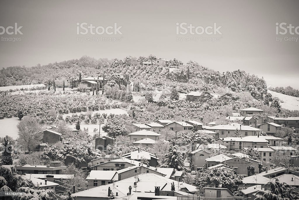 Winter landscape , houses with roofs covered of snow under hill royalty-free stock photo