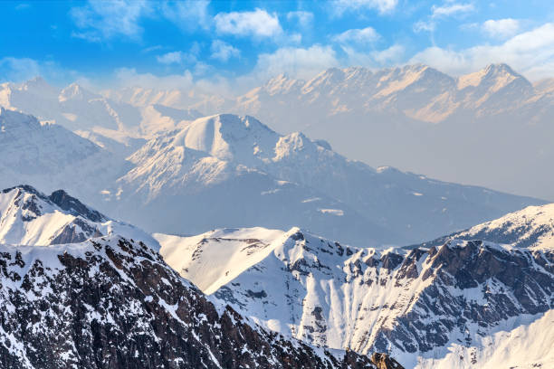 winter landscape in alps - snowy mountains stock photos and pictures