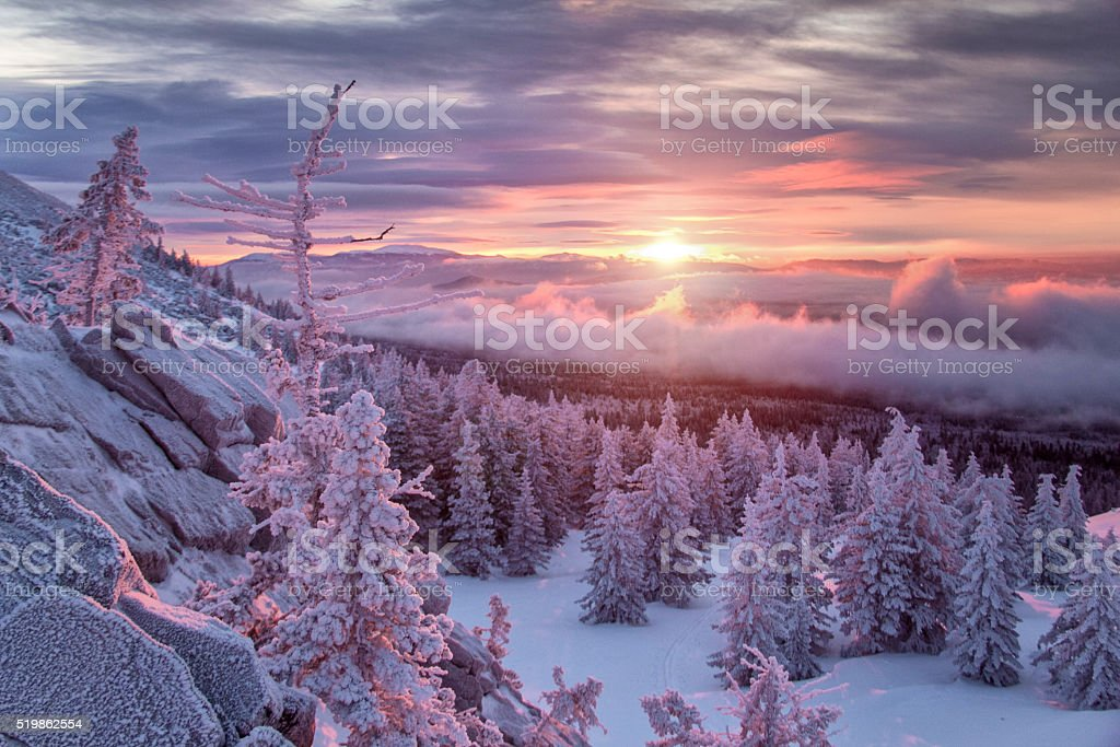 Winter landscape in mountains at sunrise stock photo