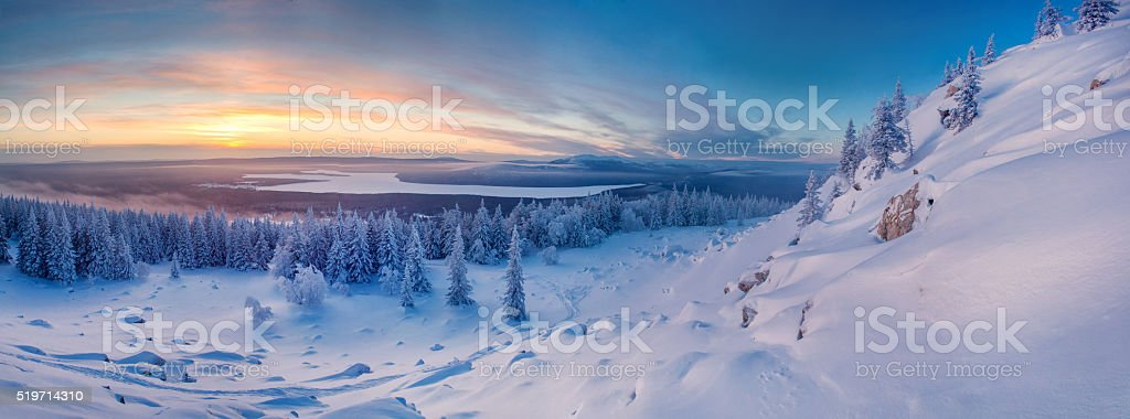 Winter landscape in mountains at the sunrise stock photo