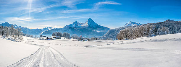 Winter landscape in the Bavarian Alps with Watzmann massif, Germany Panoramic view of beautiful winter landscape in the Bavarian Alps with cross-country slopes and famous Watzmann massif in the background, Nationalpark Berchtesgadener Land, Bavaria, Germany passenger cabin stock pictures, royalty-free photos & images