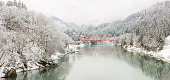 winter landscape with Red Bridge along Tadami River in Fukushima Japan Panorama