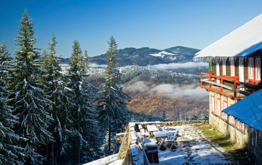 chalet in winter mountain landscape, Romanian Carpathians