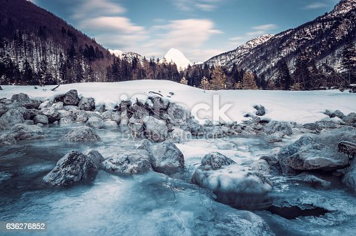 Frozen moutain river in Italian Alps