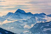 A snowy mountain range background.
