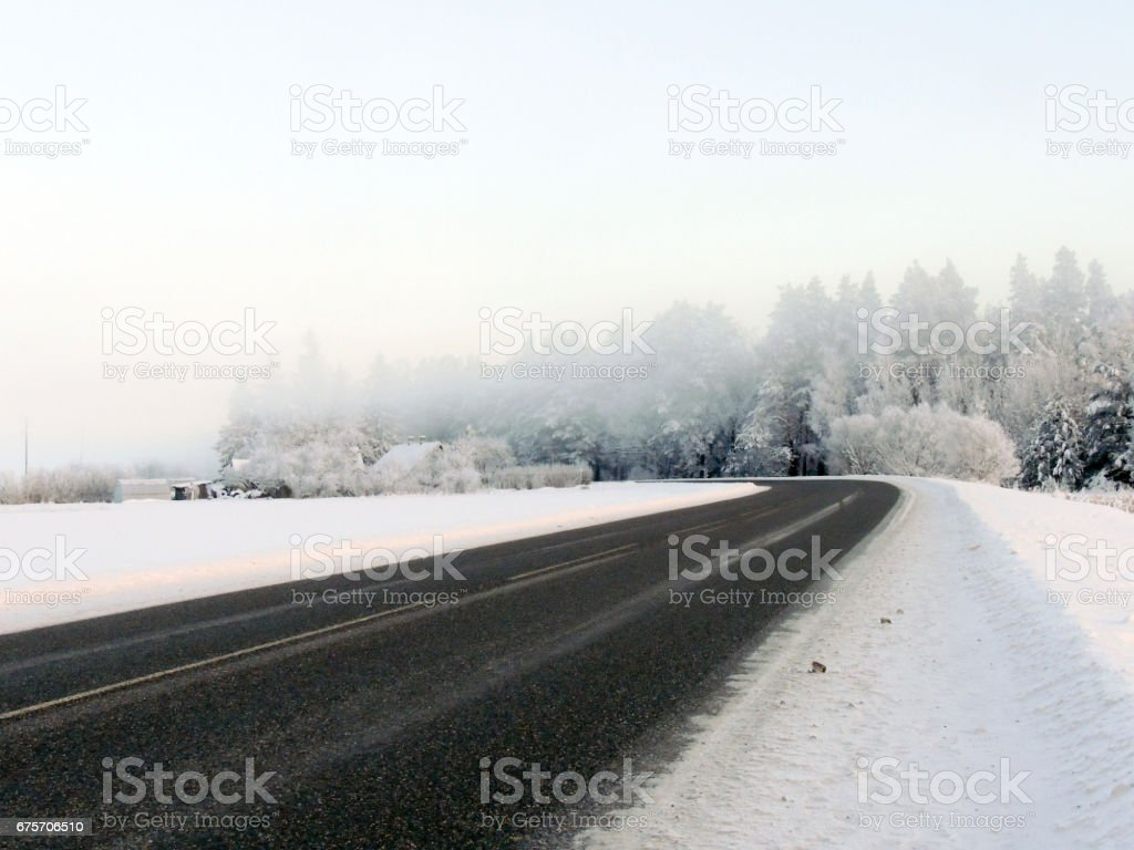 Winter landscape. Winter road in the morning mist. royalty-free stock photo