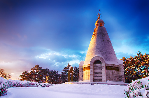 landscape, snow-covered hill with a chapel on the hill at dawn, the chapel of St. George on Sapun Hill