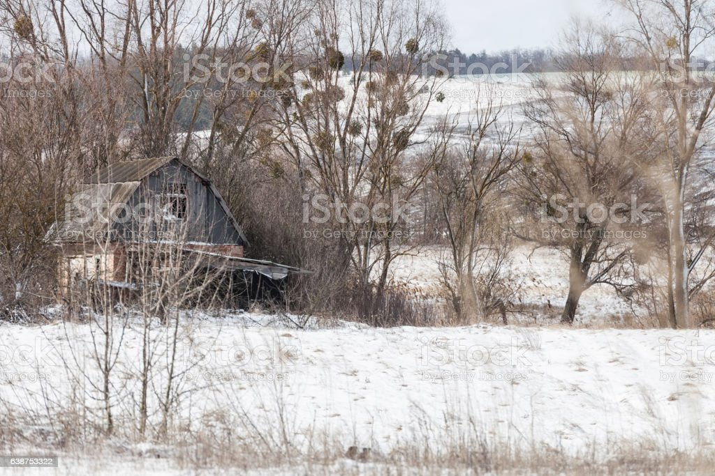 Winter landscape with abandoned house stock photo