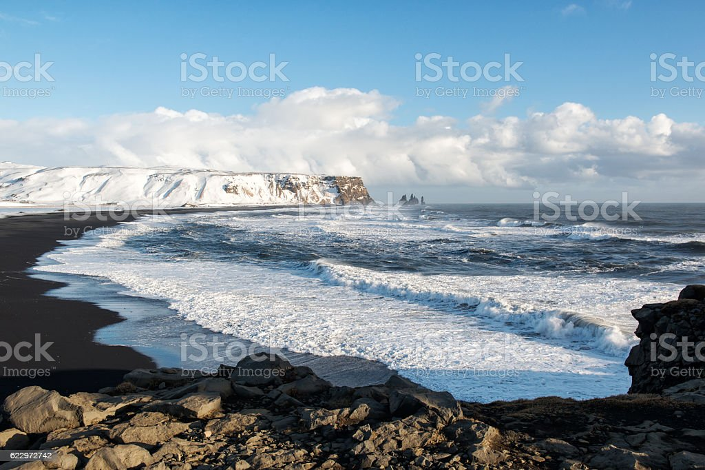 Winter landscape with black sand beach and ocean waves, Iceland stock photo