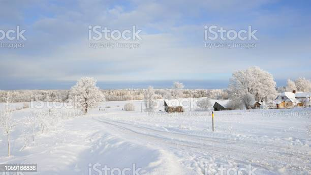Winter landscape with cozy farm houses and a snowcovered rural road picture id1059166836?b=1&k=6&m=1059166836&s=612x612&h=fe4znkjvbalhiqiwplm oconzz56wvopipr8gmumda8=