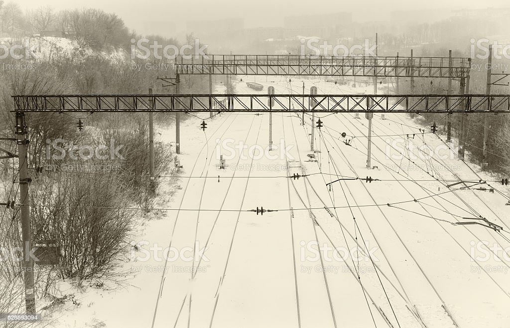 Winter landscape with empty railway infrastructure in Ukraine stock photo