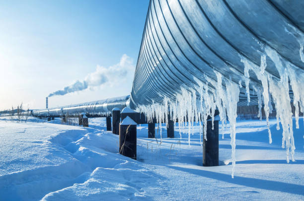 Winter landscape with icicles on the gas pipeline stock photo