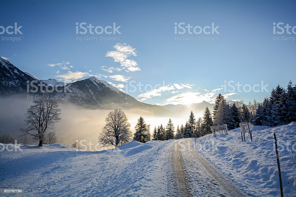 Winter landscape with icy road near Salzburg in Austria, Europe stock photo