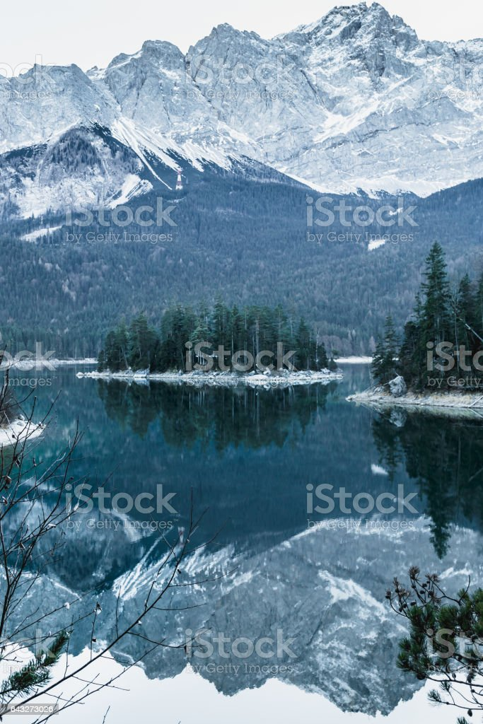 Winter landscape with lake and mountains, Zugspitze, Eibsee, Germany stock photo