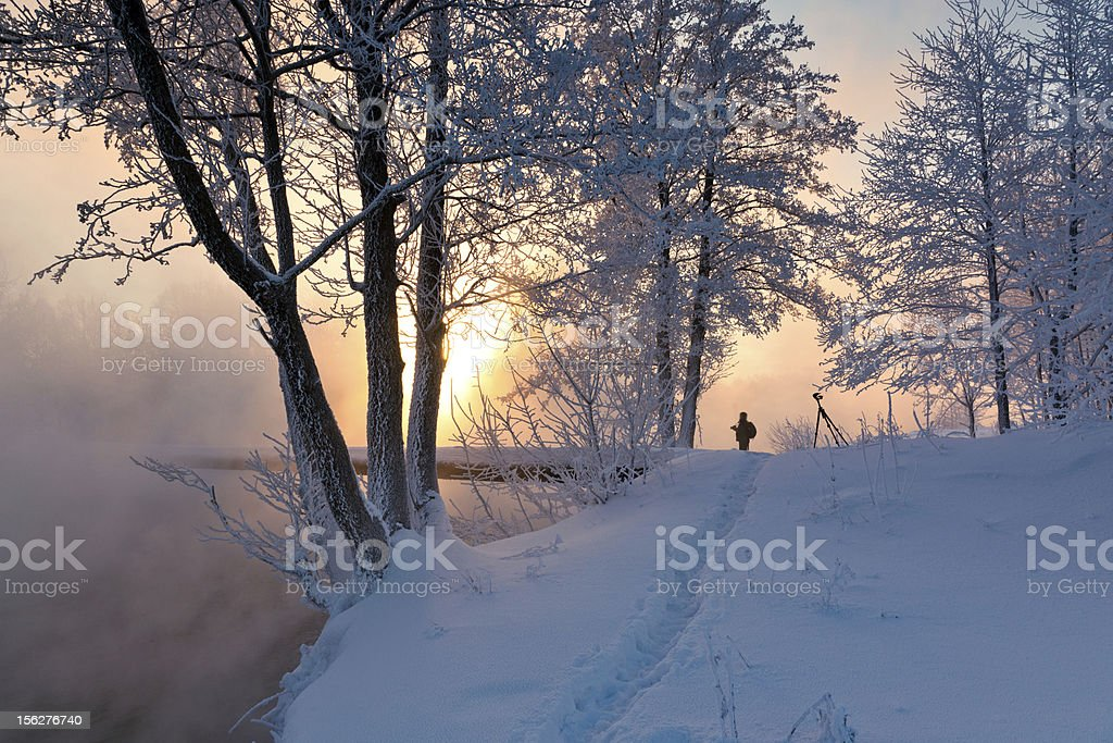Winter landscape with misty river and frozen trees at sunrise royalty-free stock photo