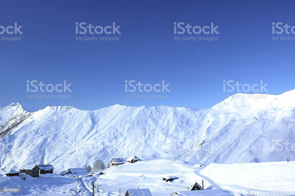 Winter landscape with mountains and houses royalty-free stock photo