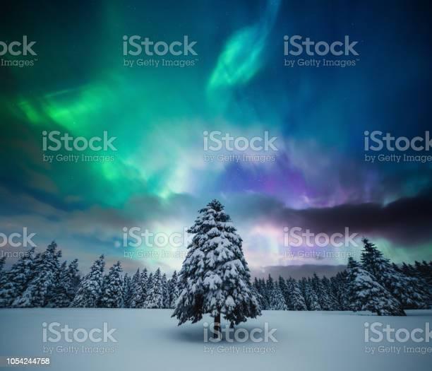 Winter landscape with northern lights picture id1054244758?b=1&k=6&m=1054244758&s=612x612&h=dxrjwkldpq6aewjsh2dkx zz4vlpr5leq8wygwnkvxc=