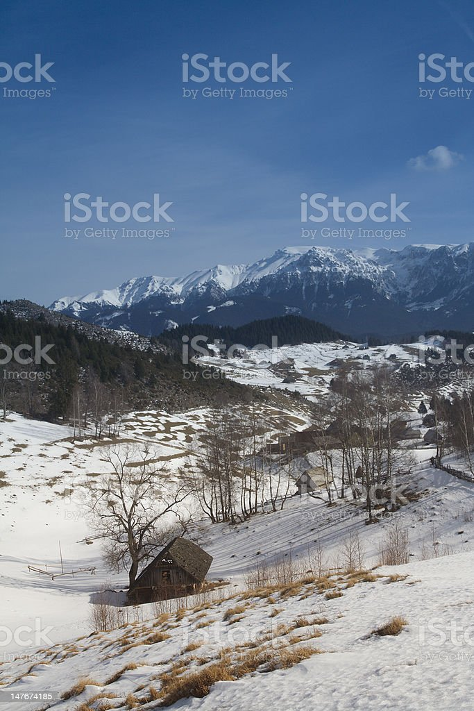Winter landscape with old house stock photo