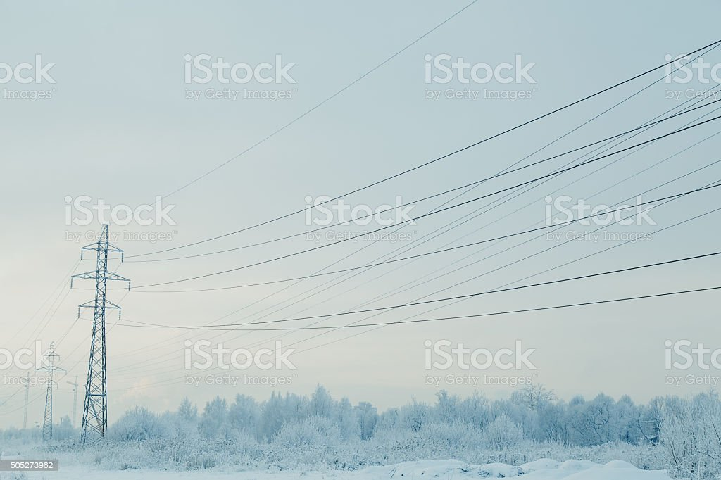 Winter landscape with power line. stock photo