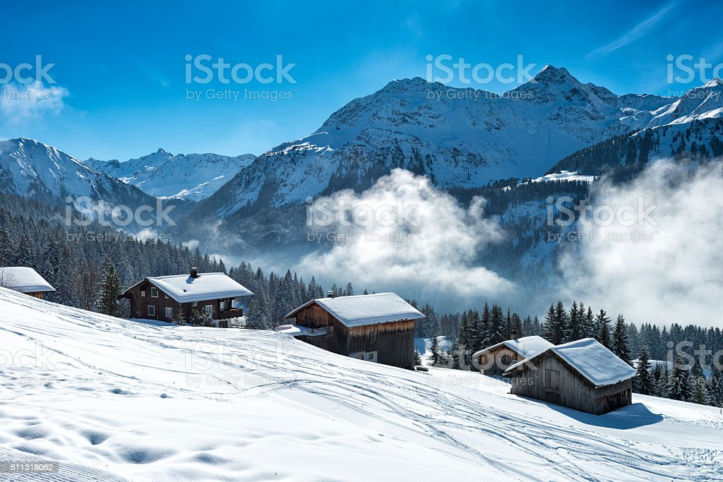 winter landscape with ski lodge in austrian alps stock photo