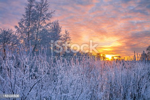 istock winter landscape with sunset 183434506