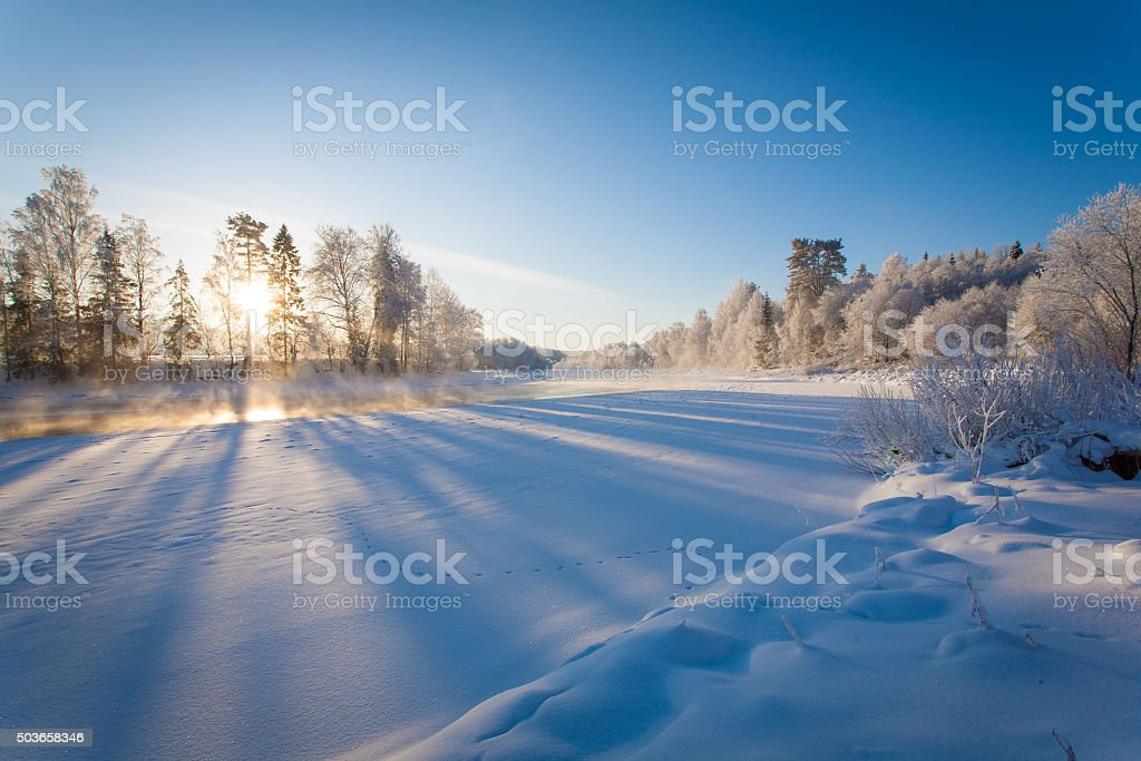 Winter landscape with the river at dawn stock photo