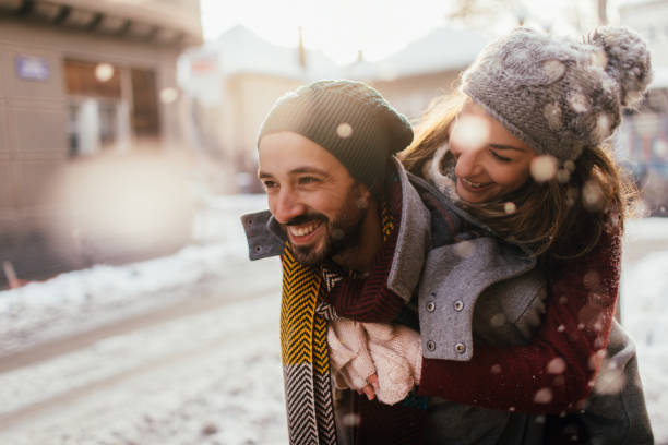Winter love Romantic couple on a snowy day piggyback stock pictures, royalty-free photos & images