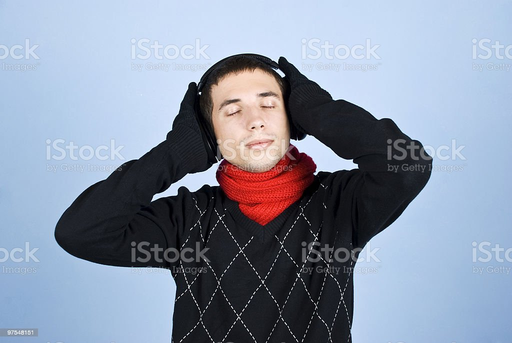 Winter man enjoying music headphones royalty-free stock photo