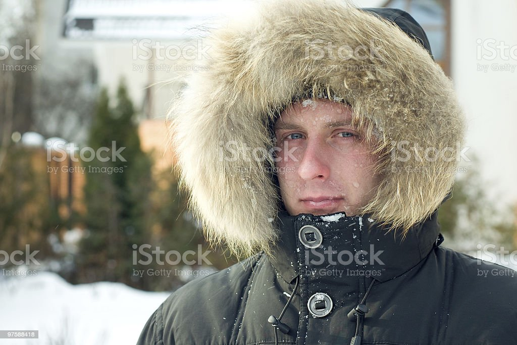 Winter - man in warm jacket with furry hood royalty-free stock photo