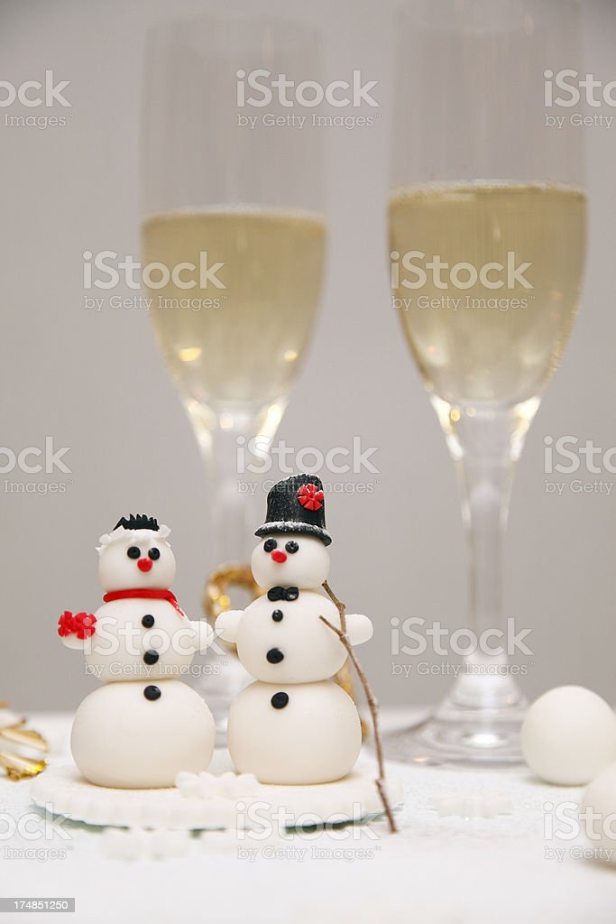 Winter marzipan decoration with snowman and champagne royalty-free stock photo