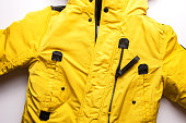Winter men's yellow jacket on a white background.