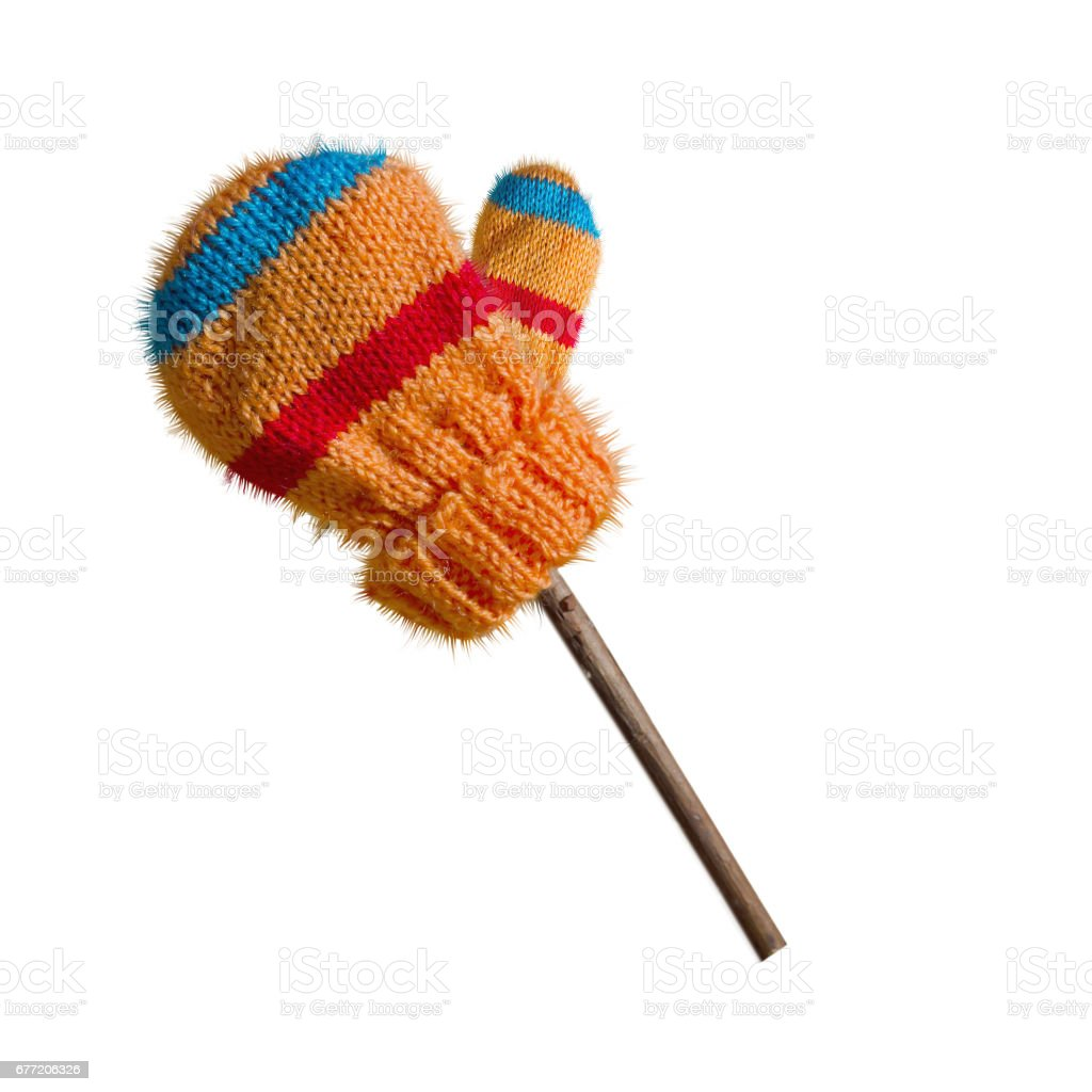 Winter mitten, knitted, isolated on white background. Alone on the twig stock photo