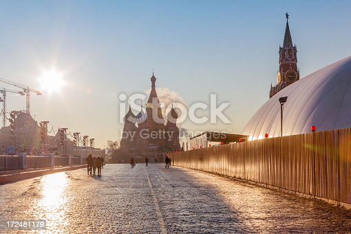 Sunny view of the Pokrovsky Cathedral (St. Basil's) and the Spassky Tower at the Red Square, Moscow, Russia