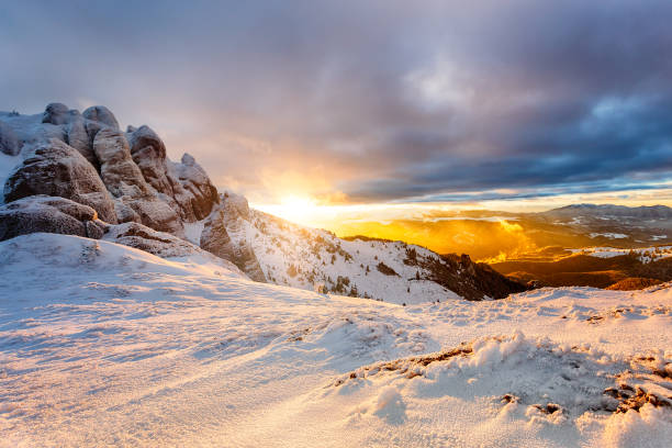 Winter mountain Sunset. Landscape with dramatic clouds and snow stock photo