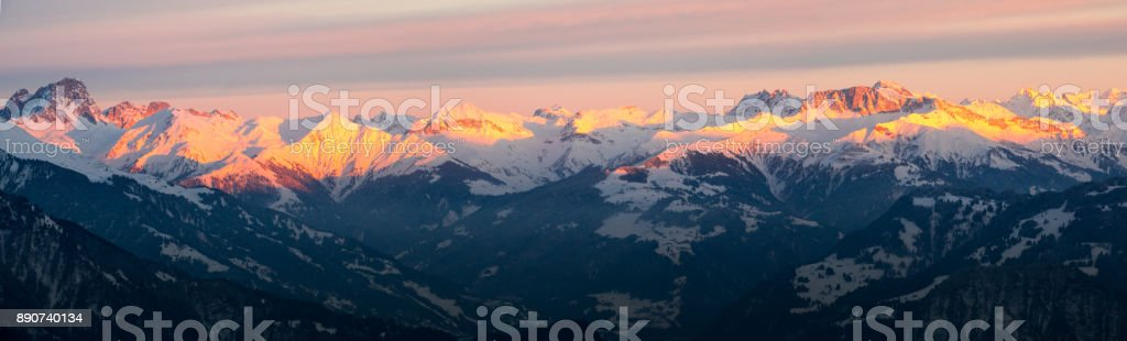 winter mountains in the Alps in evening light during sunset stock photo
