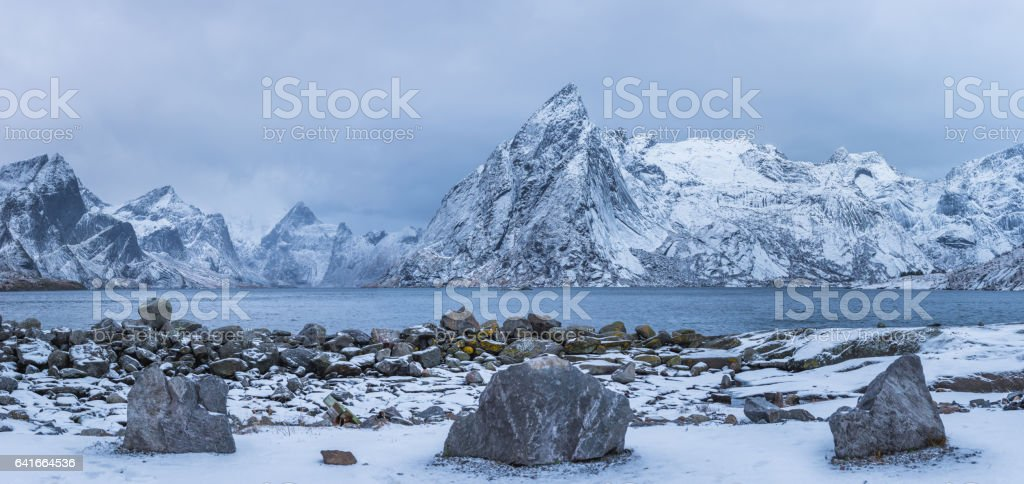 Winter mountains panorama view with stones at foreground stock photo
