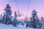 istock Winter mountains panorama with ski slopes and ski lifts 909307378
