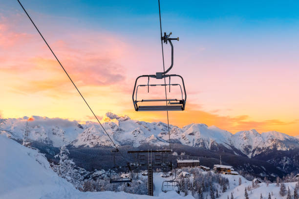 Winter mountains panorama with ski slopes and ski lifts stock photo