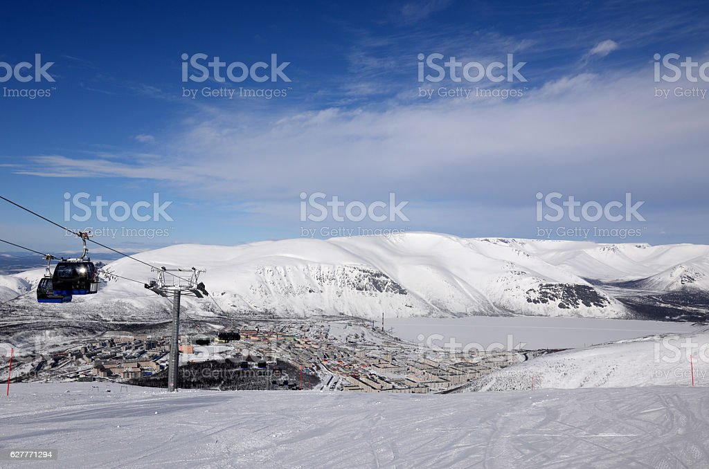 Winter mountains  with frozen lake and  downhill skiing stock photo