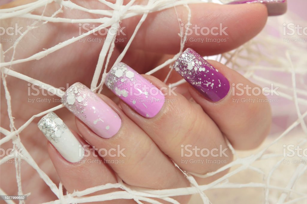 Winter multi-colored lilac pastel manicure стоковое фото