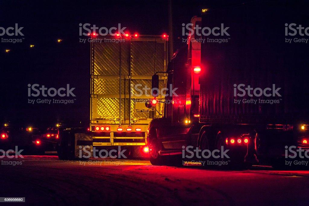 Winter Night Bright Lights Rest Stop Parked Semi Trailer Trucks stock photo