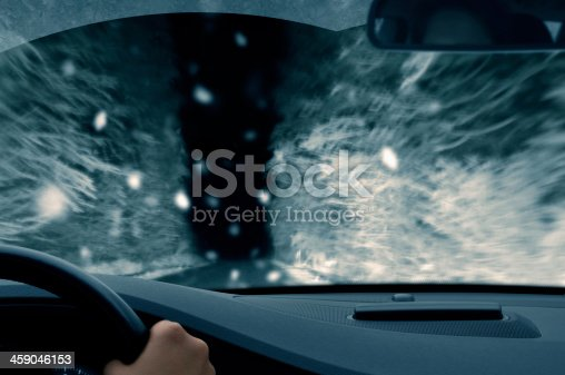 482803237 istock photo winter night driving - snowfall on a country road 459046153