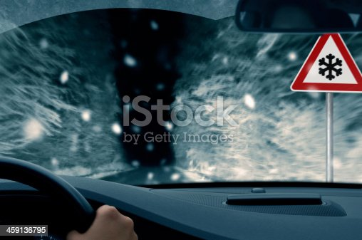 482803237 istock photo winter night driving - snowfall on a country road 459136795