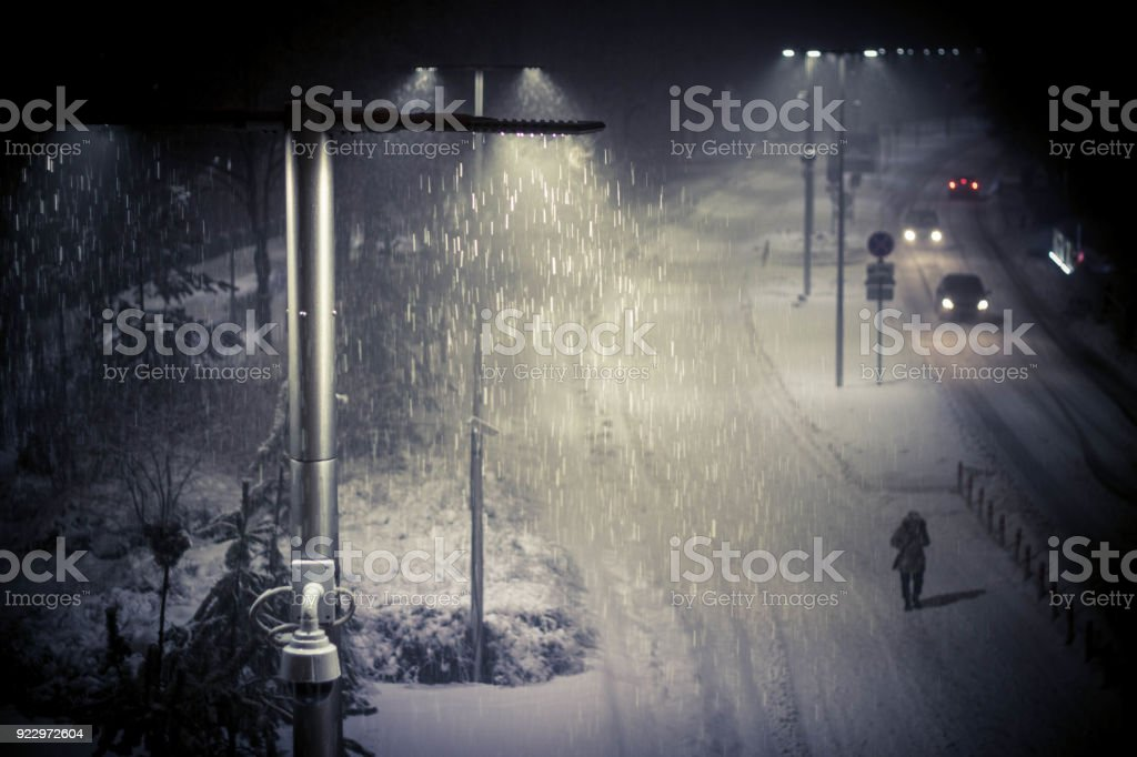 winter night landscape, snowfall, street with lanterns stock photo