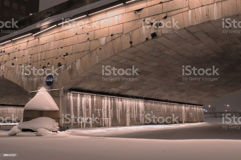 Winter night under the Pitkäsilta bridge, Helsinki royalty-free stock photo