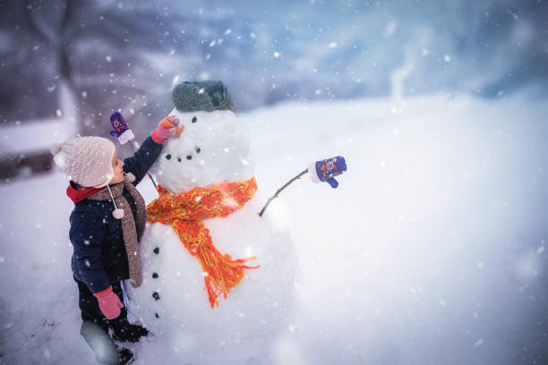 Winter outdoor activities for a child stock photo