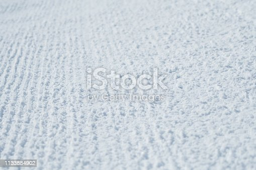 istock Winter picture. The texture of the trampled snow on the ski track. Bright abstract background ideal for any design 1133884902