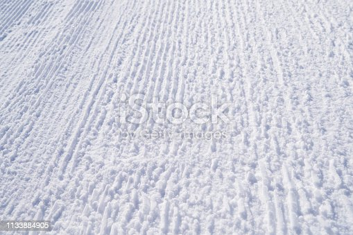 istock Winter picture. The texture of the trampled snow on the ski track. Bright abstract background ideal for any design 1133884905